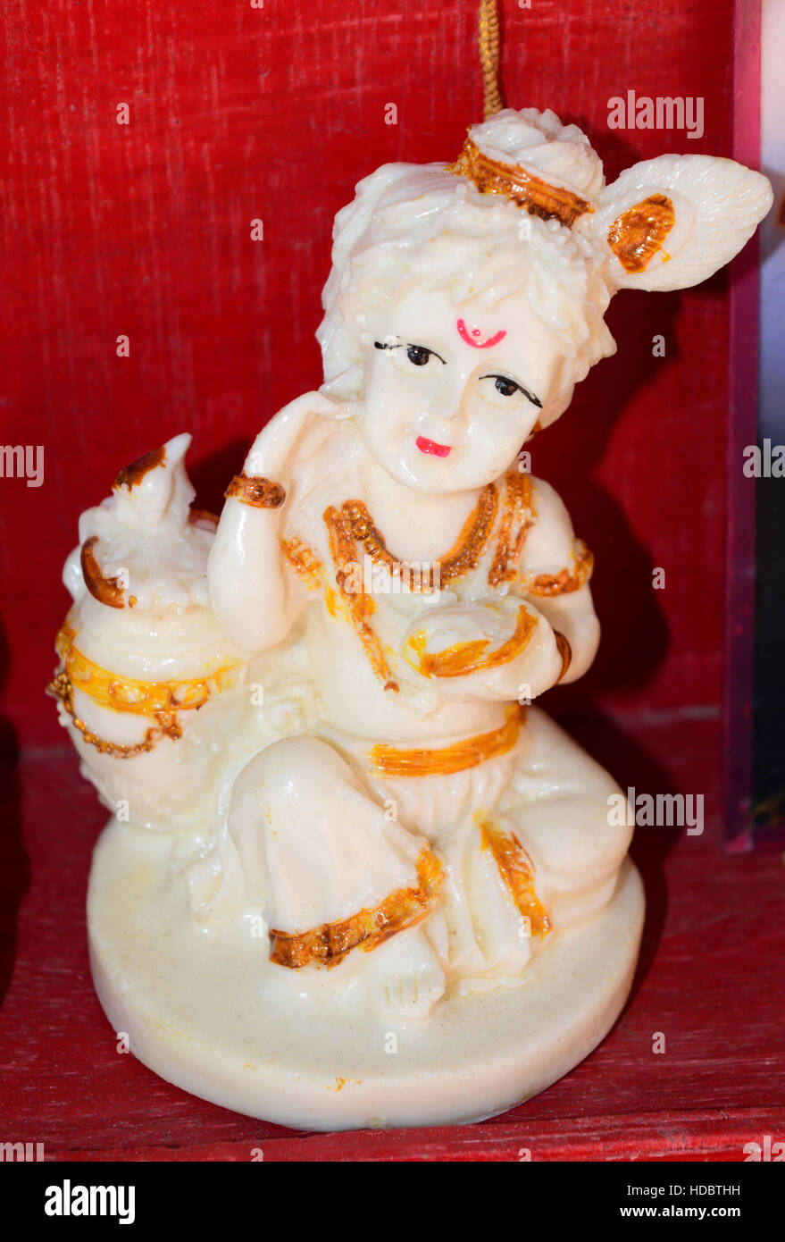 Child Krishna holding Butter Beautiful Handcrafts Statue India - Stock Image