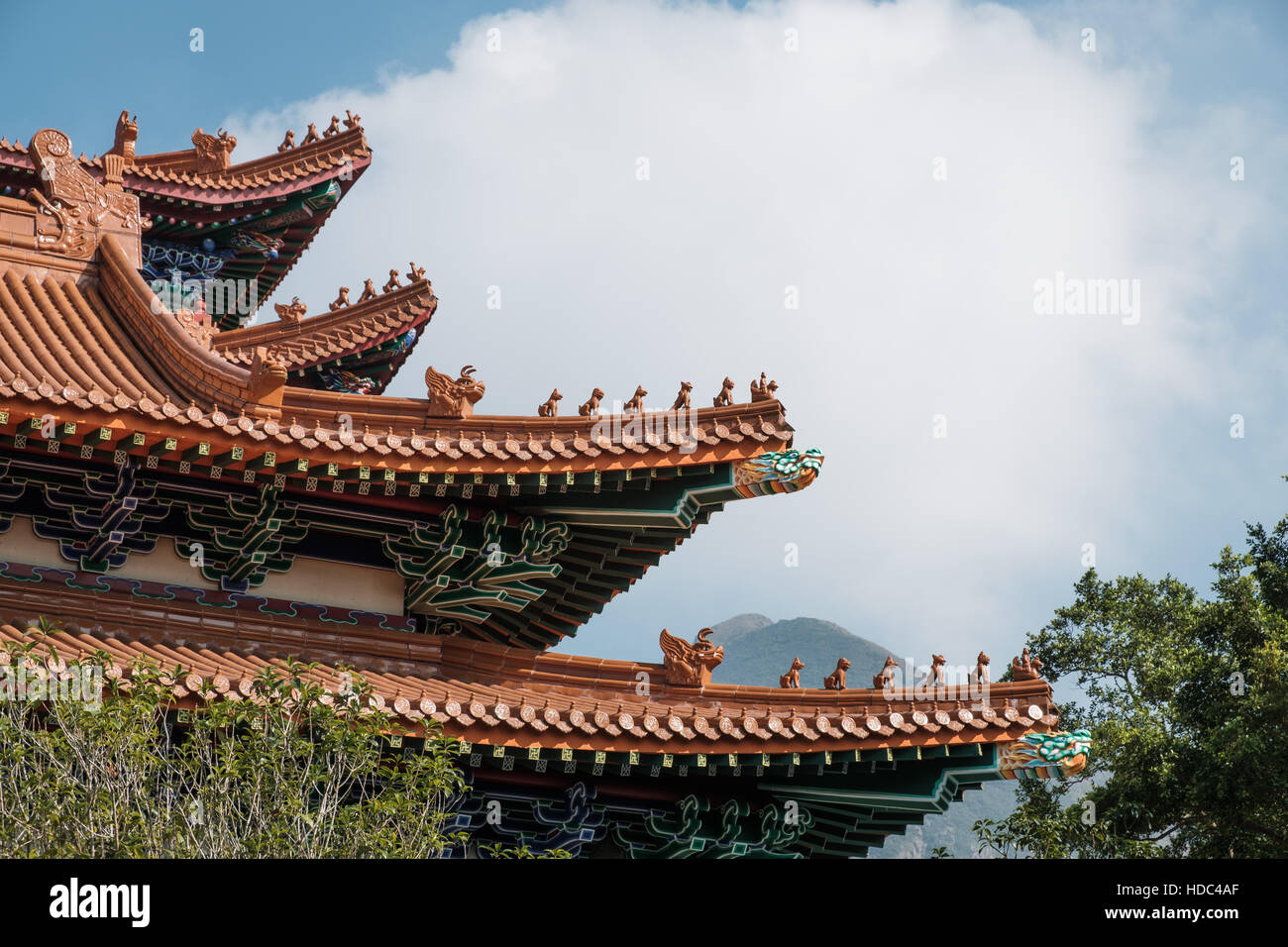 Part of the roof showing decorative creatures and animals at the main shrine Po Lin Monastery Lantau Island Hong - Stock Image