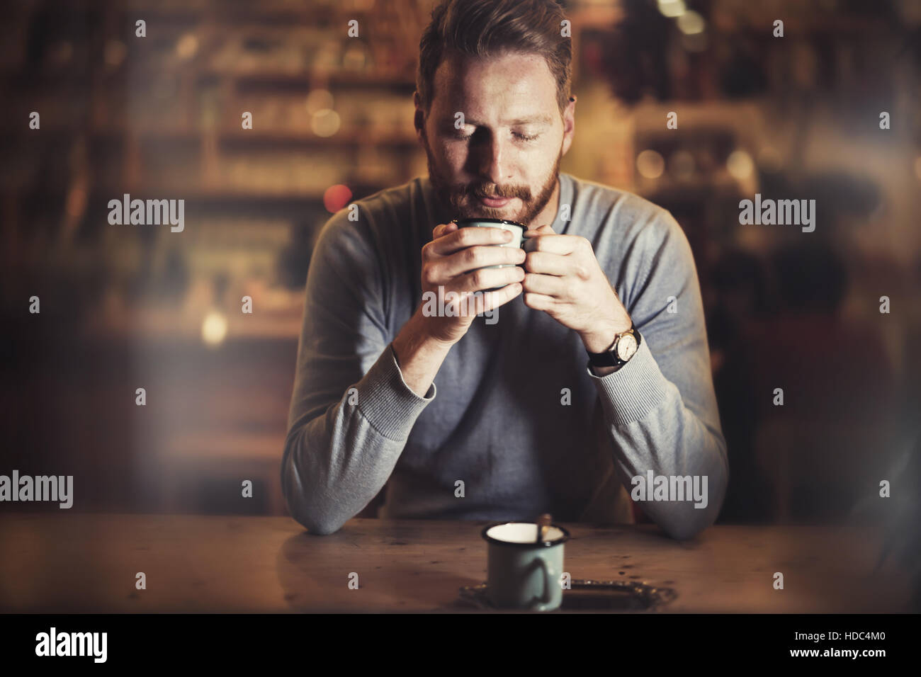 Man enjoying his aromatic cup of coffee - Stock Image