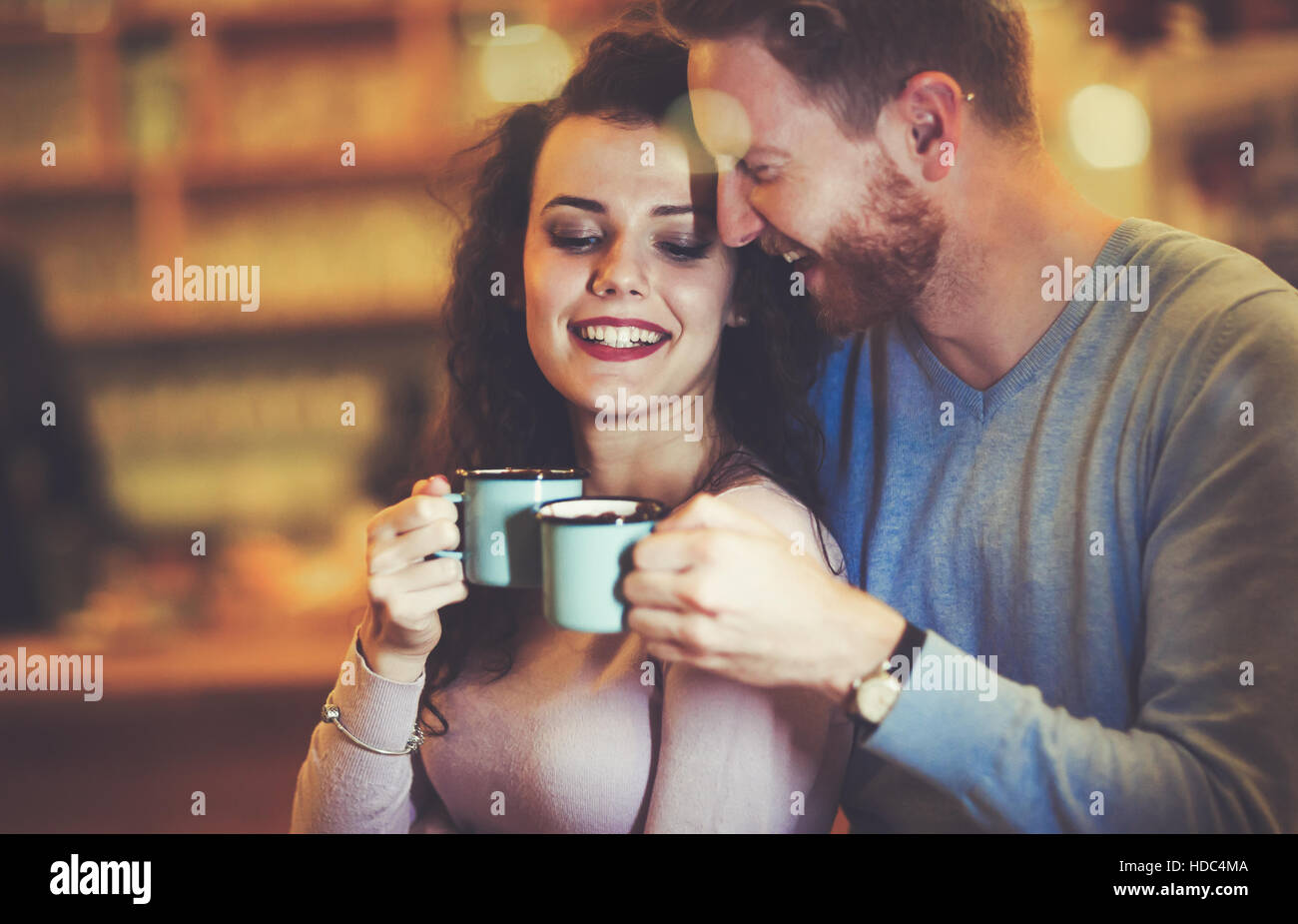 Couple in love dating in restaurant at xmas - Stock Image