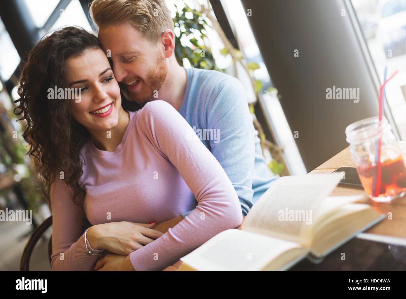 Romantic couple in love bonding in cafe - Stock Image