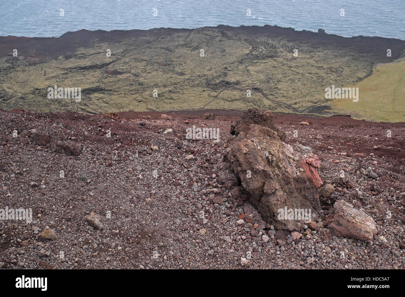 The extent of the lava field seen over volcanic rocks of Eldfell, Heimaey, Vestmannaeyjar Islands, southern Iceland - Stock Image