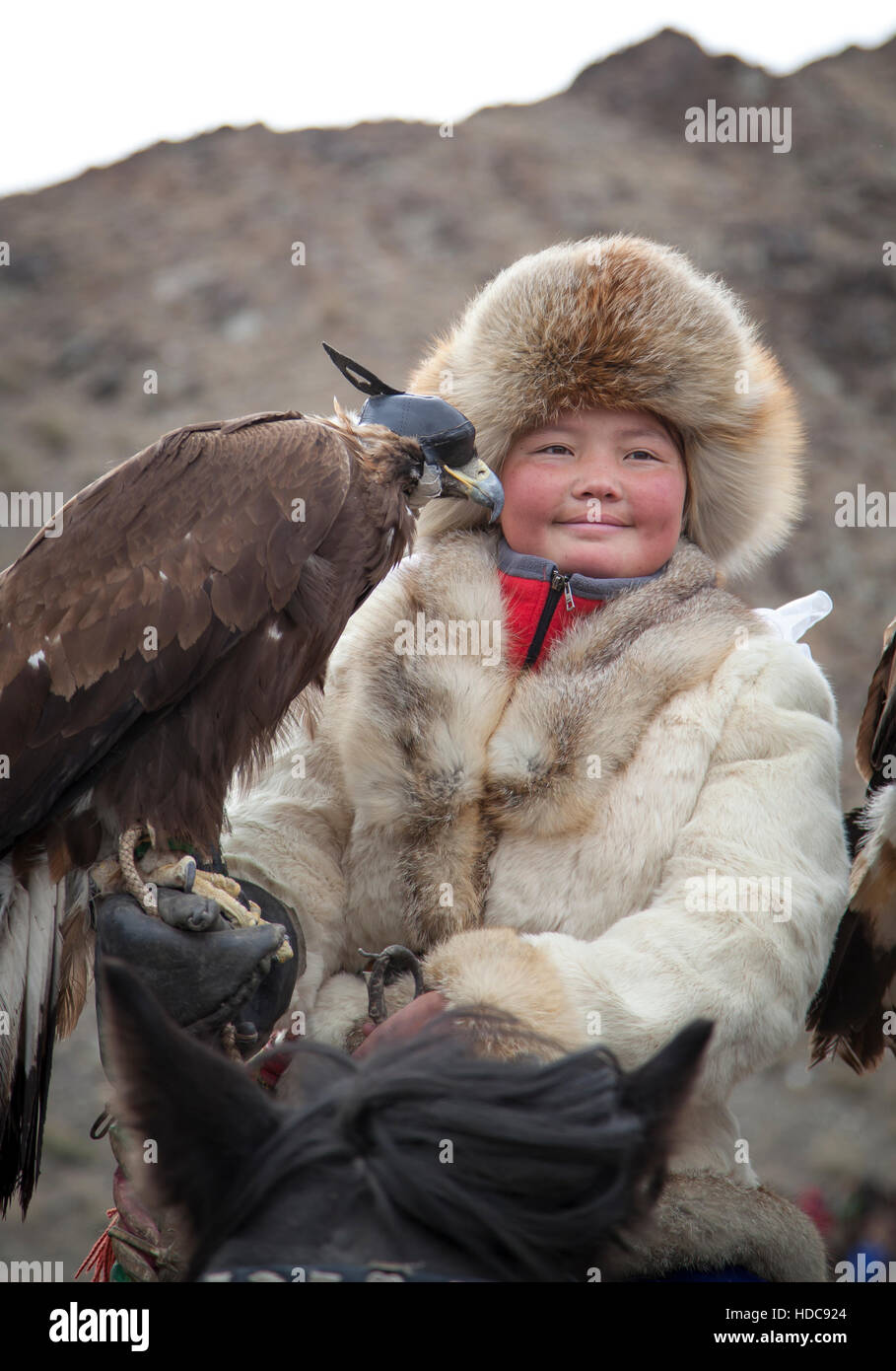 Bayan Ulgii, Mongolia, October 4th, 2015: Eagle huntress  with her Altai Golden Eagle Stock Photo