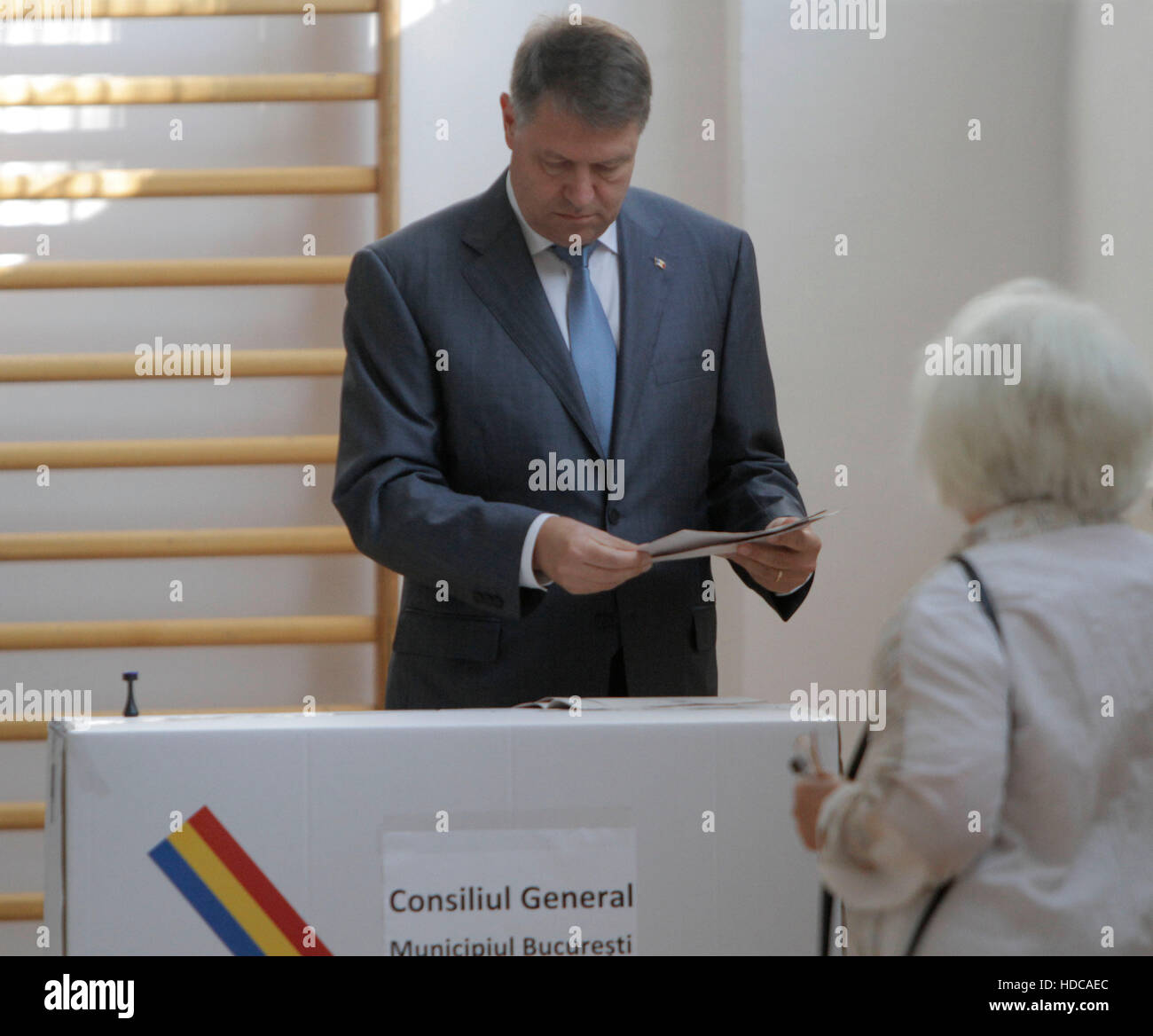 BUCHAREST, ROMANIA - MAY 05, 2016: Romanian President Klaus Iohannis casts his vote in local elections. Stock Photo