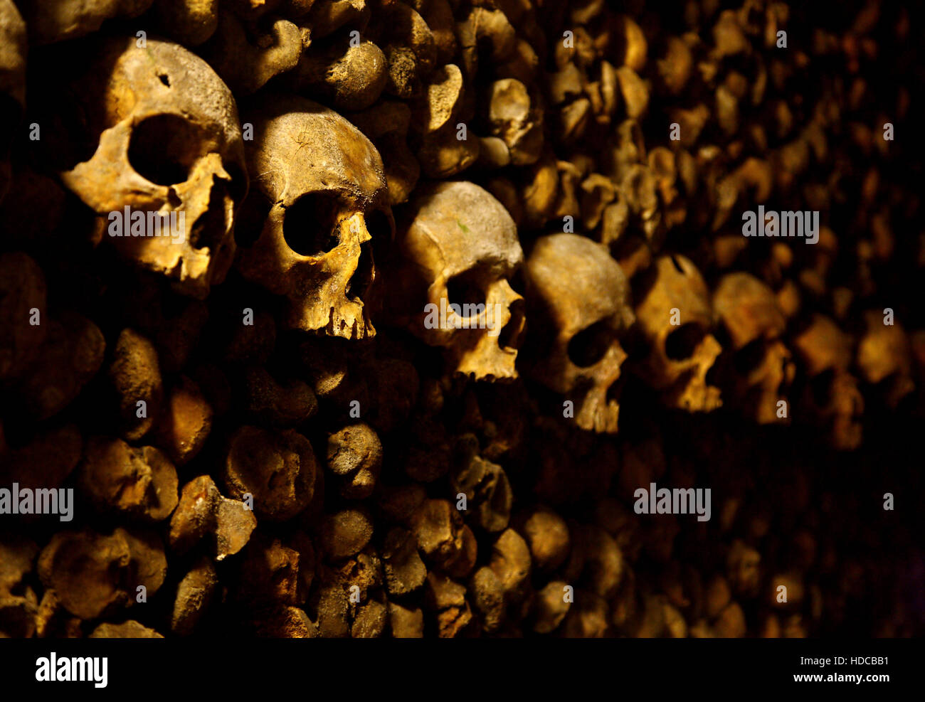 In the Catacombs of Paris, a huge ossuary in some abandoned mines in Montparnasse, Paris, France. - Stock Image