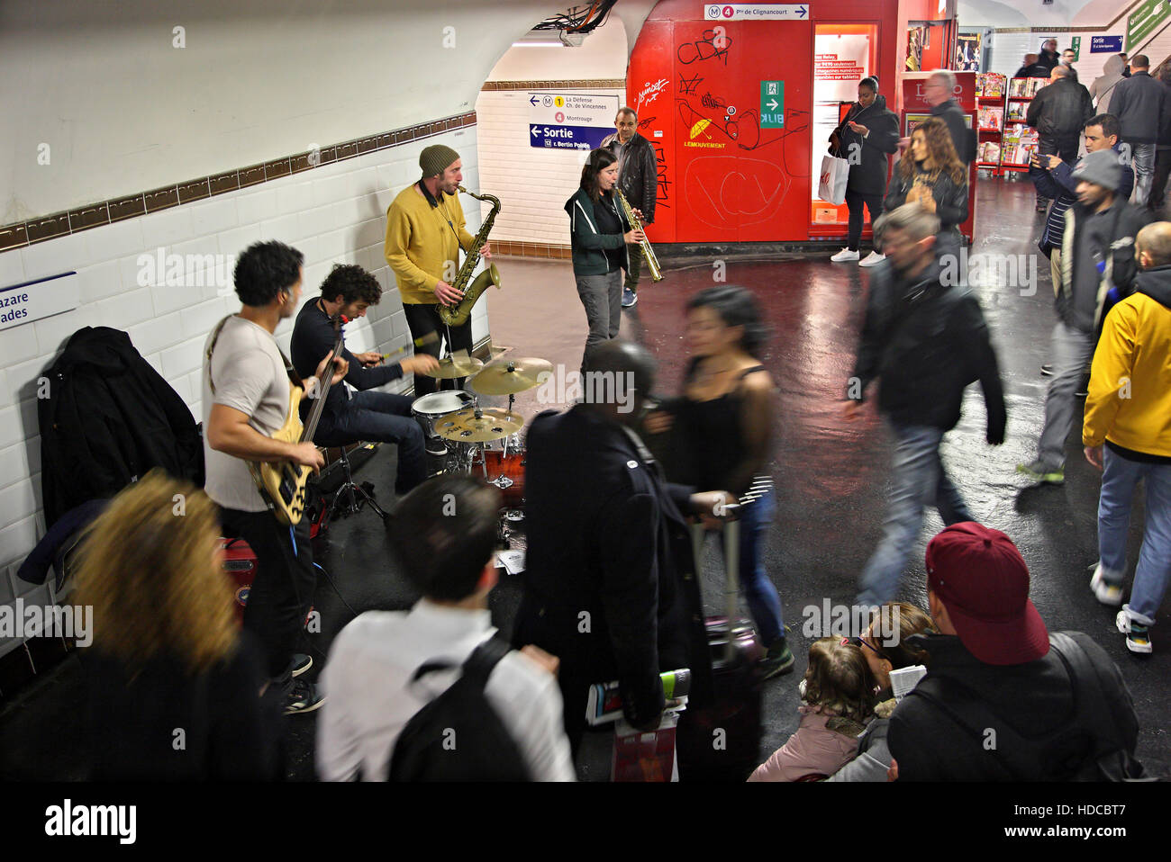 Music band (called 'Les Mutants de l'Espace') playing in a metro station of Paris, France. - Stock Image