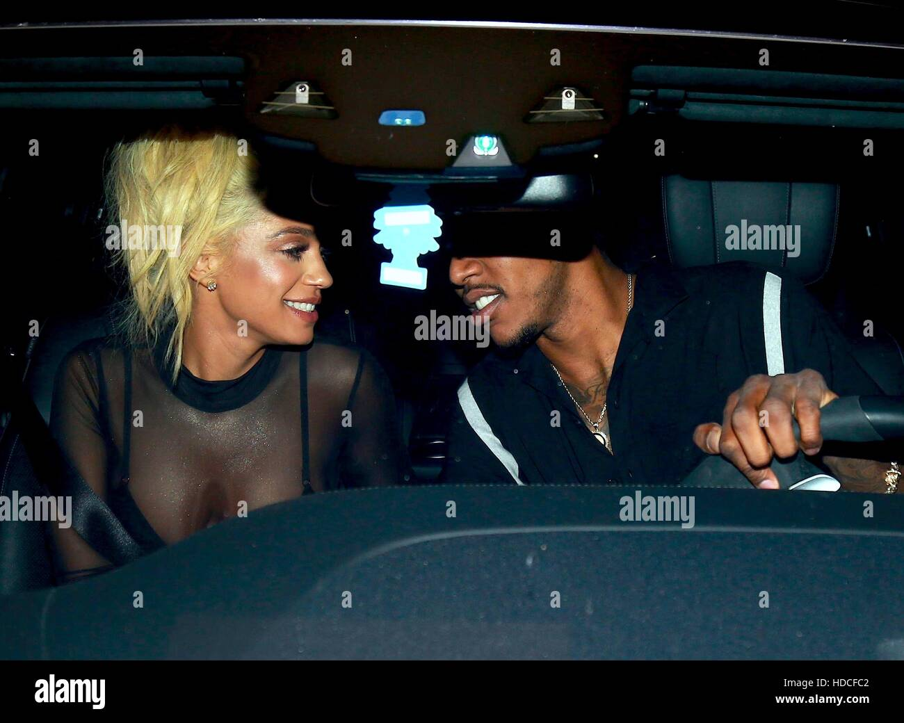 Nick Young at The Nice Guy with a mystery woman in Los Angeles. The couple are seen kissing in the car as they left. - Stock Image