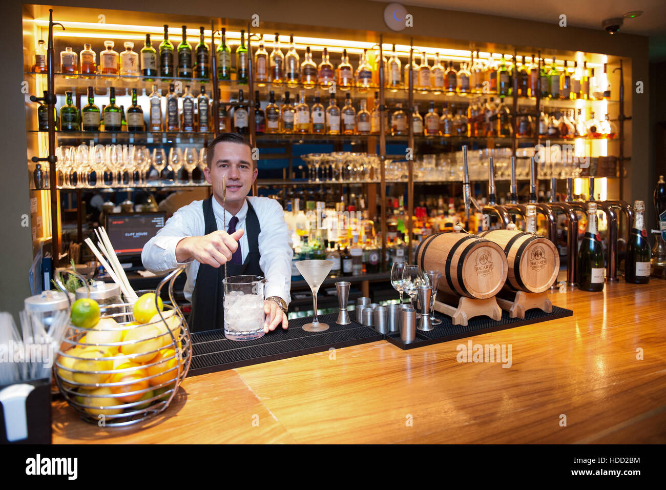 A barman mixing a cocktail at the bar in the five star Cliff House Hotel, Ardmore, County Waterford, Ireland - Stock Image