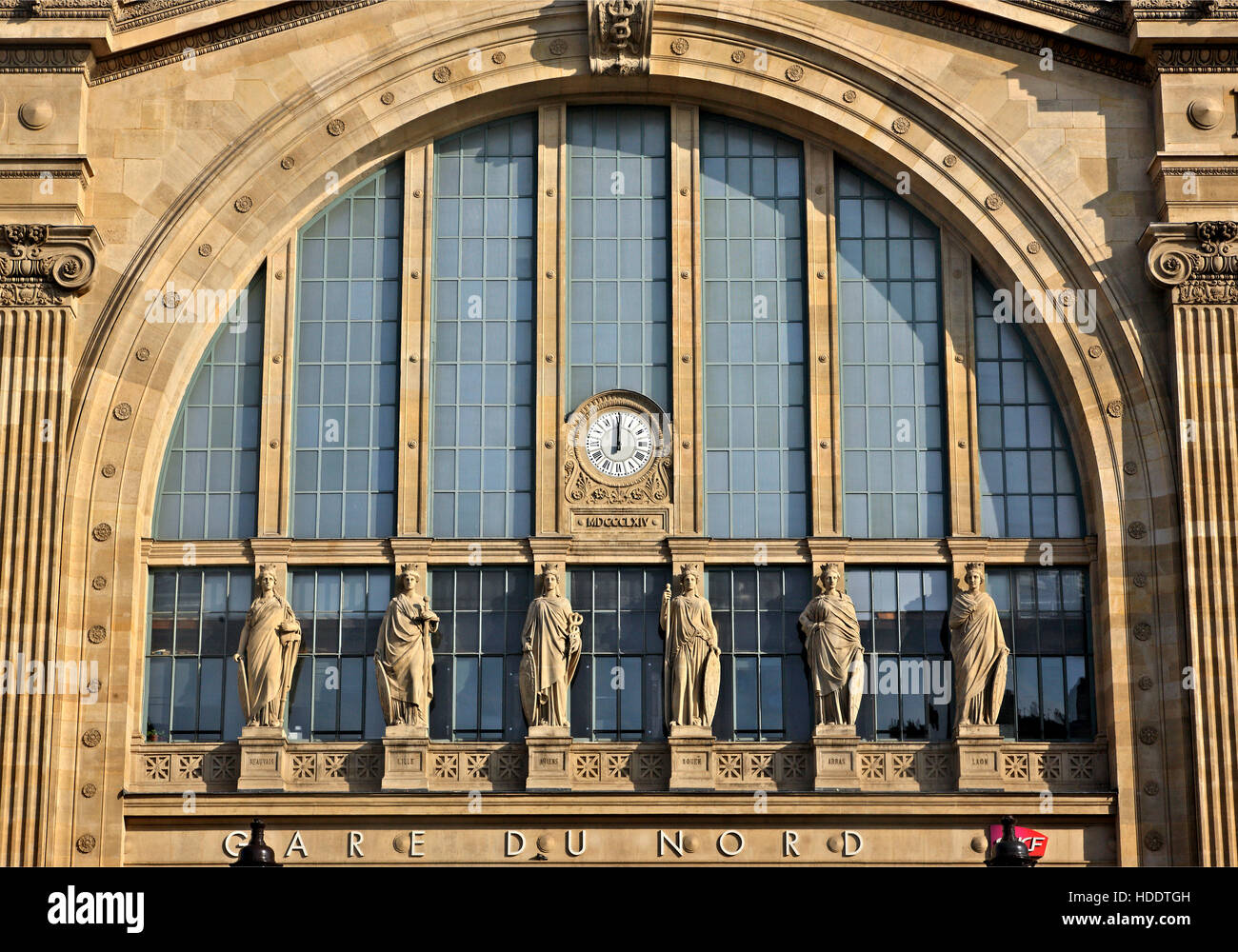 'Detail' from the facade of Gare du Nord ('North Station') the bussiest train station in Europe. - Stock Image