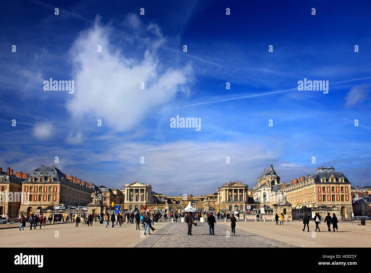 Tourists outside the Palace of Versailles, France. - Stock Image