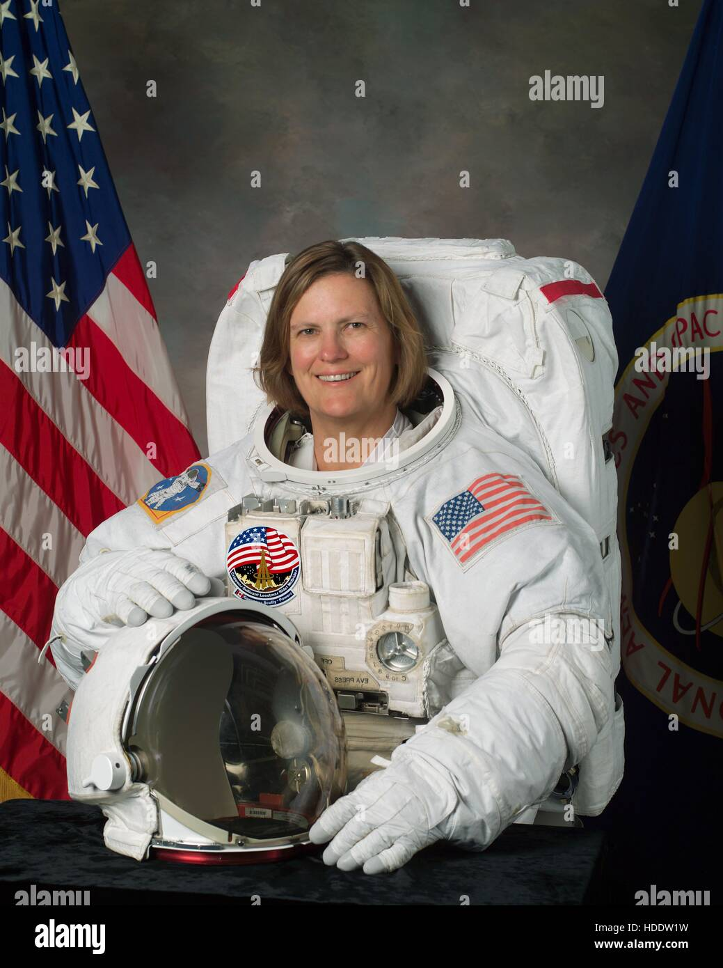 Official NASA portrait of astronaut Kathy Sullivan, posing in a spacesuit at the Johnson Space Center July 25, 2003 - Stock Image