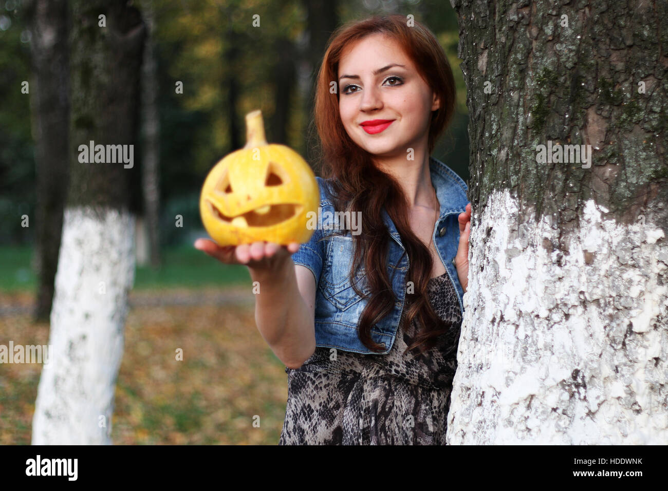 red haired girl halloween pumpkin stock photos & red haired girl