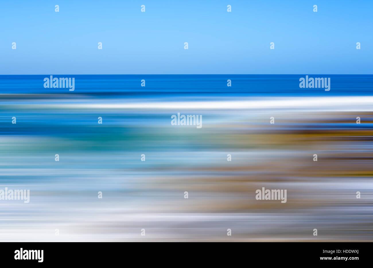 beach and ocean view, motion blur, defocused sea. - Stock Image