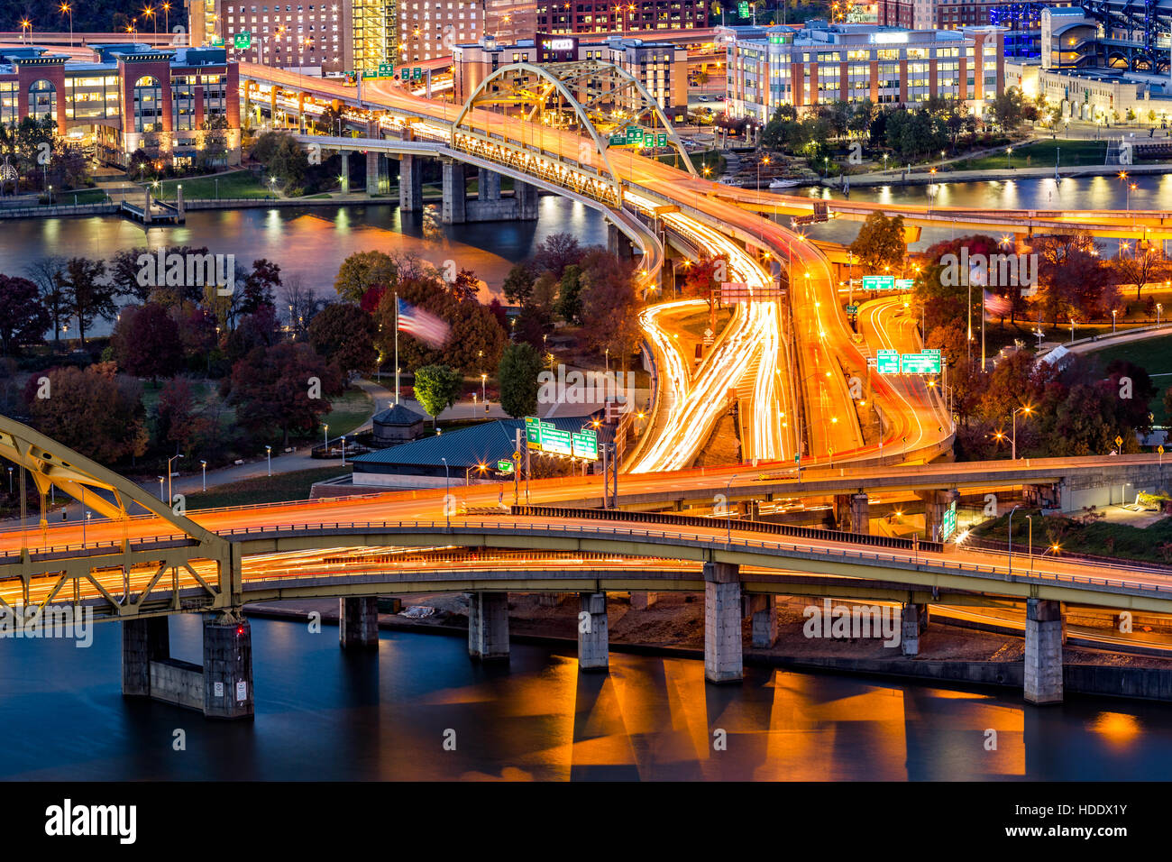 Pittsburgh traffic trails on the highway junction between Fort Duquesne and Fort Pitt bridges - Stock Image