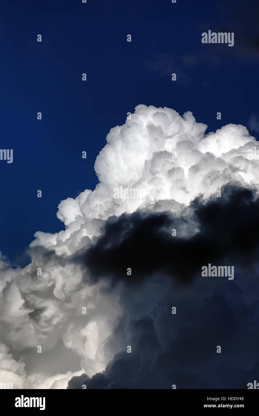 storm cloud in a blue sky - Stock Image