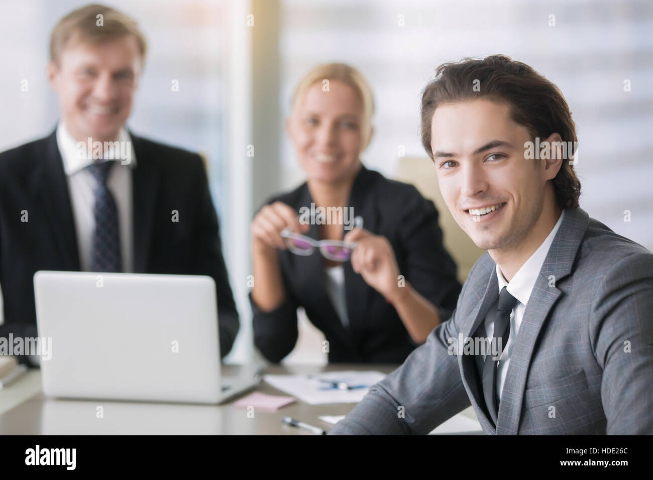 Group of business people and a smiling young man Stock Photo