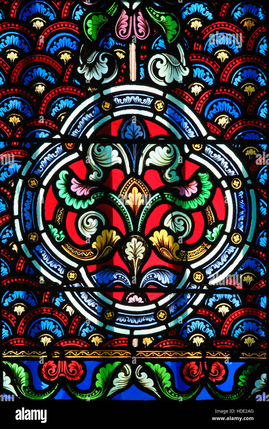 Stained Glass in Church of Saint-Germain-des-Pres in Paris, depicting a decorative pattern - Stock Image