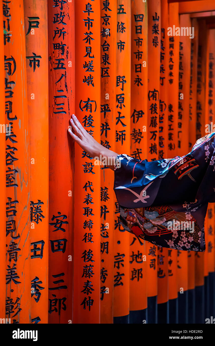 Unidentified woman at walkway in Fushimi Inari shrine in Kyoto, Japan. - Stock Image