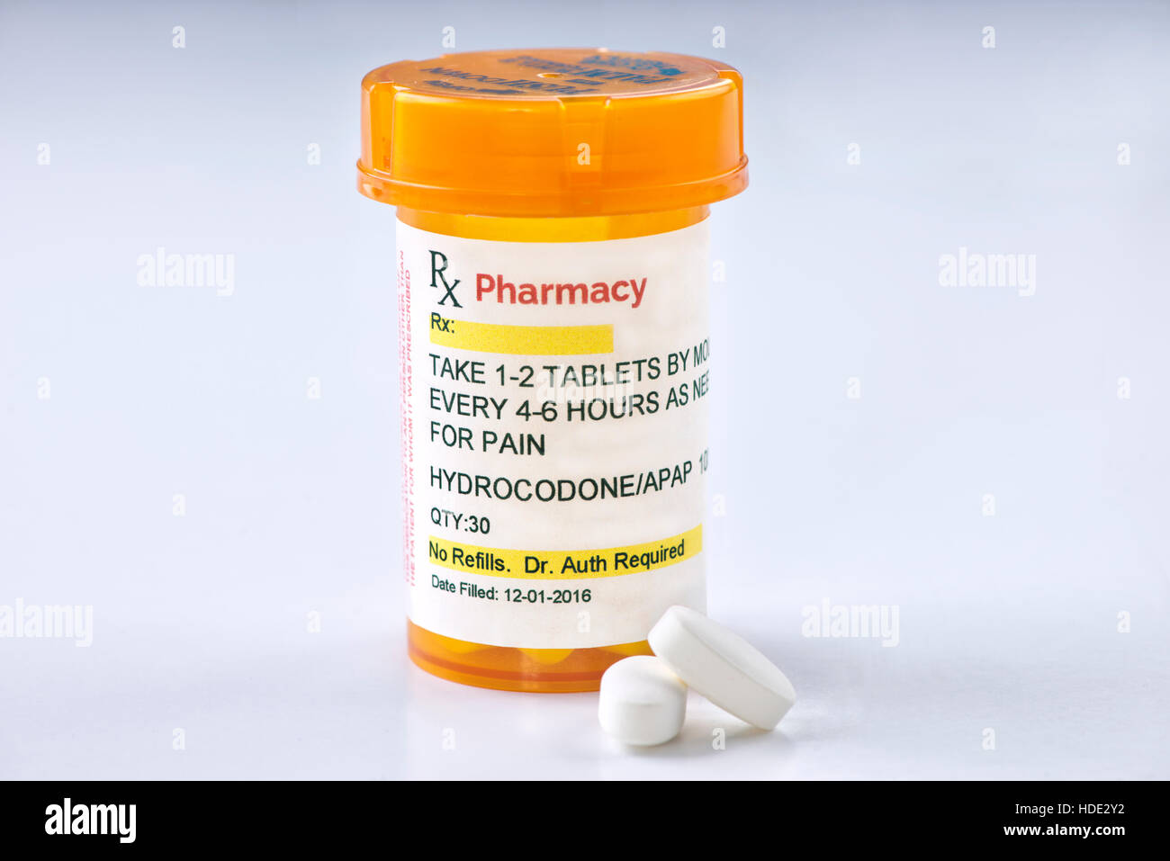 Hydrocodone prescription bottle.  Hydrocodone is a generic medication name and label was created by photographer. - Stock Image