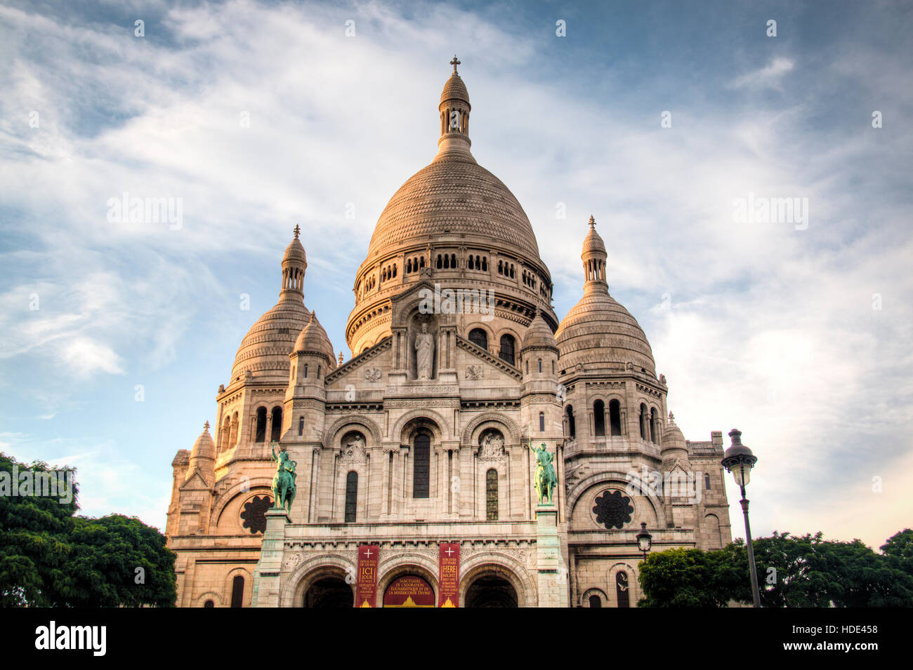 View of the Sacre Coeur church on top of Montmartre in Paris in France - Stock Image