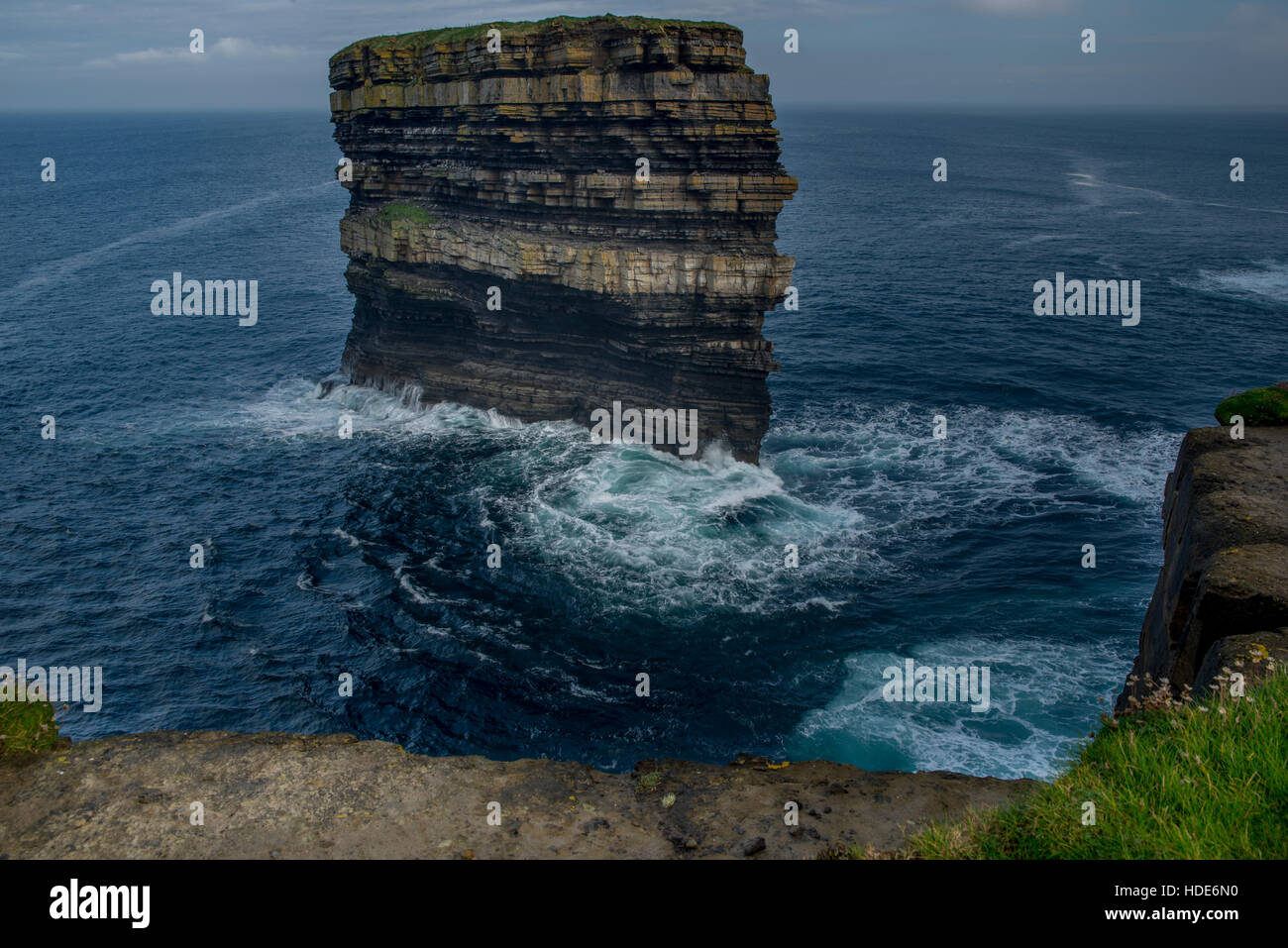 The coast of Downpatrick Head and spectacular lonely sea stack Dun Briste Stock Photo