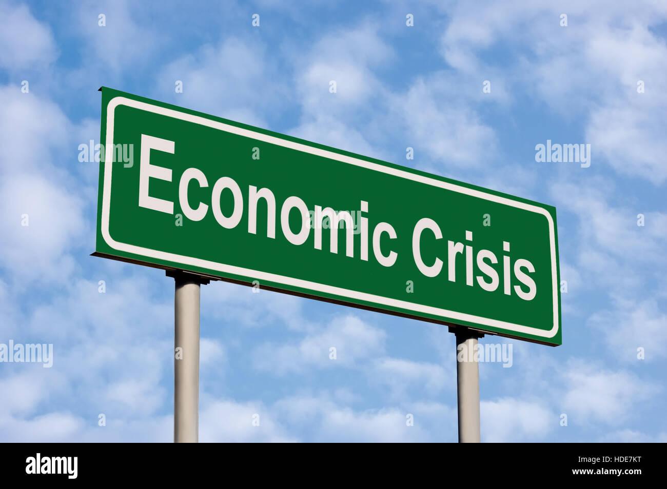Economic Crisis Green Road Sign, Against Light Cloudscape Sky - Stock Image