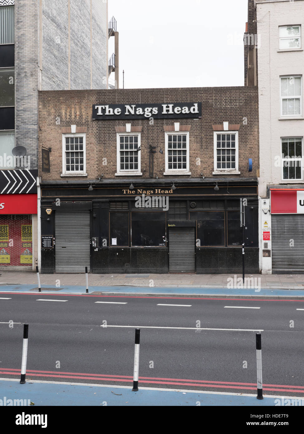 The Nag's Head public house on Whitechapel High Street in London's East End - Stock Image