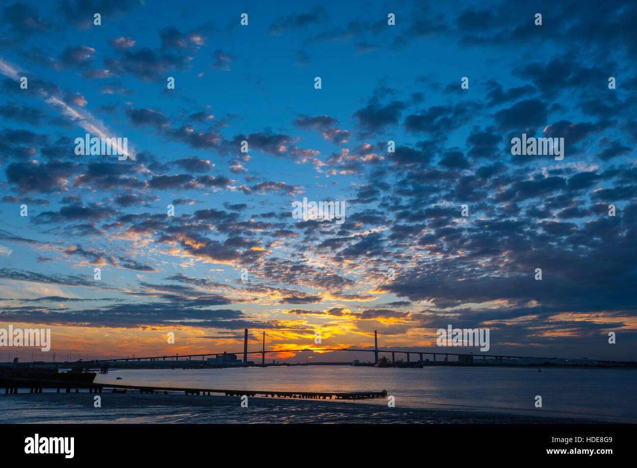 The dartford crossing bridge at sunset from the promenade at Greenhithe kent. - Stock Image