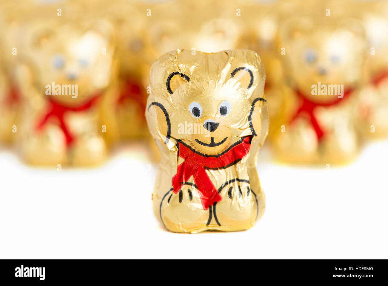 Chocolate bears in golden foil - Stock Image