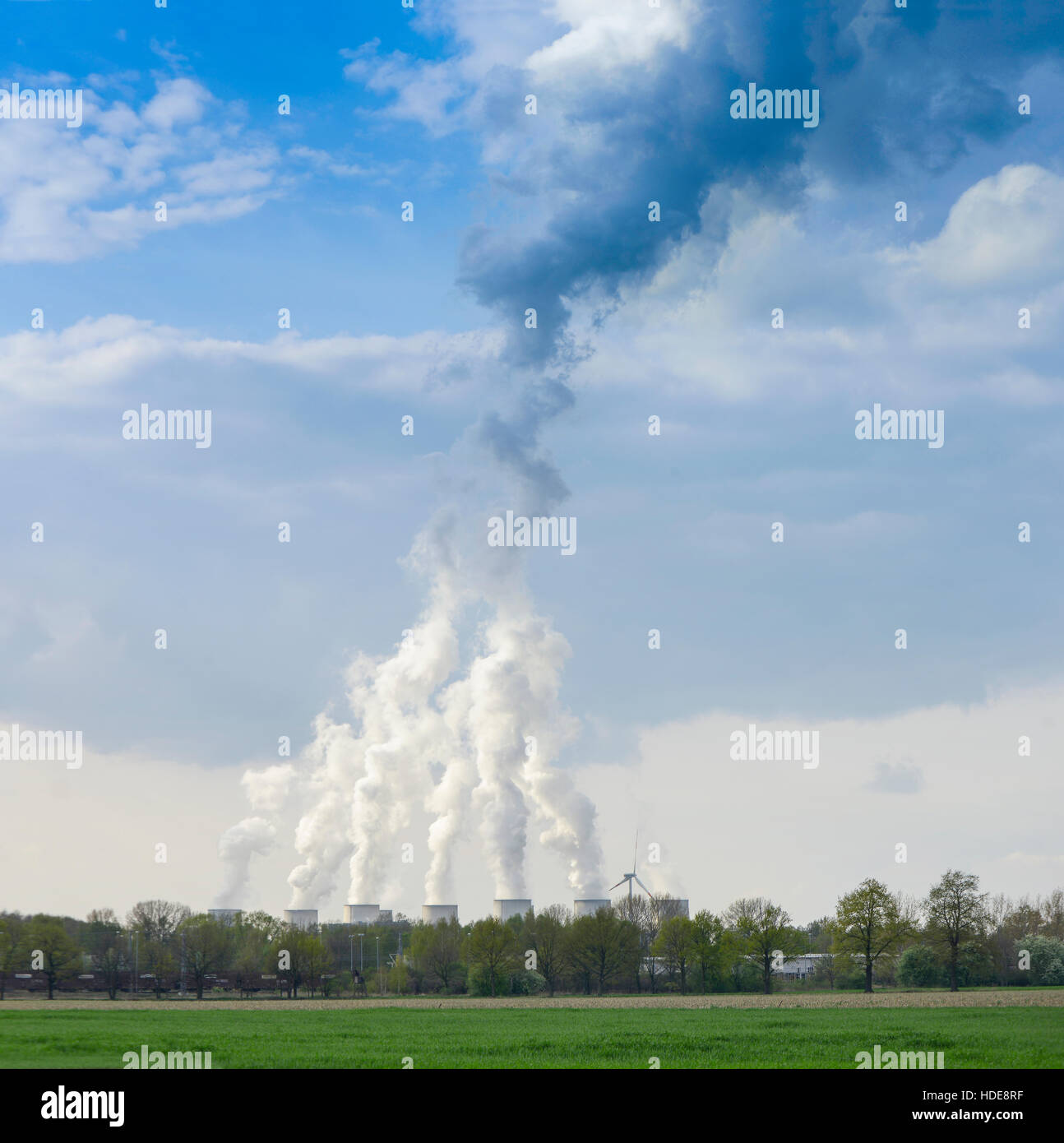 Nuclear Power plant with green grass and blue sky Stock Photo