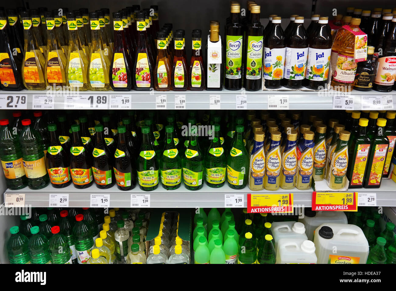 Oil and vinegar products in REWE supermarket - Stock Image