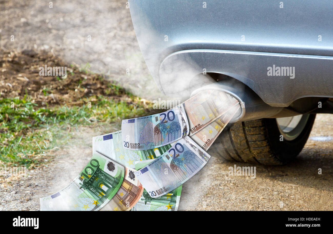 Exhaust of a car with money - Stock Image