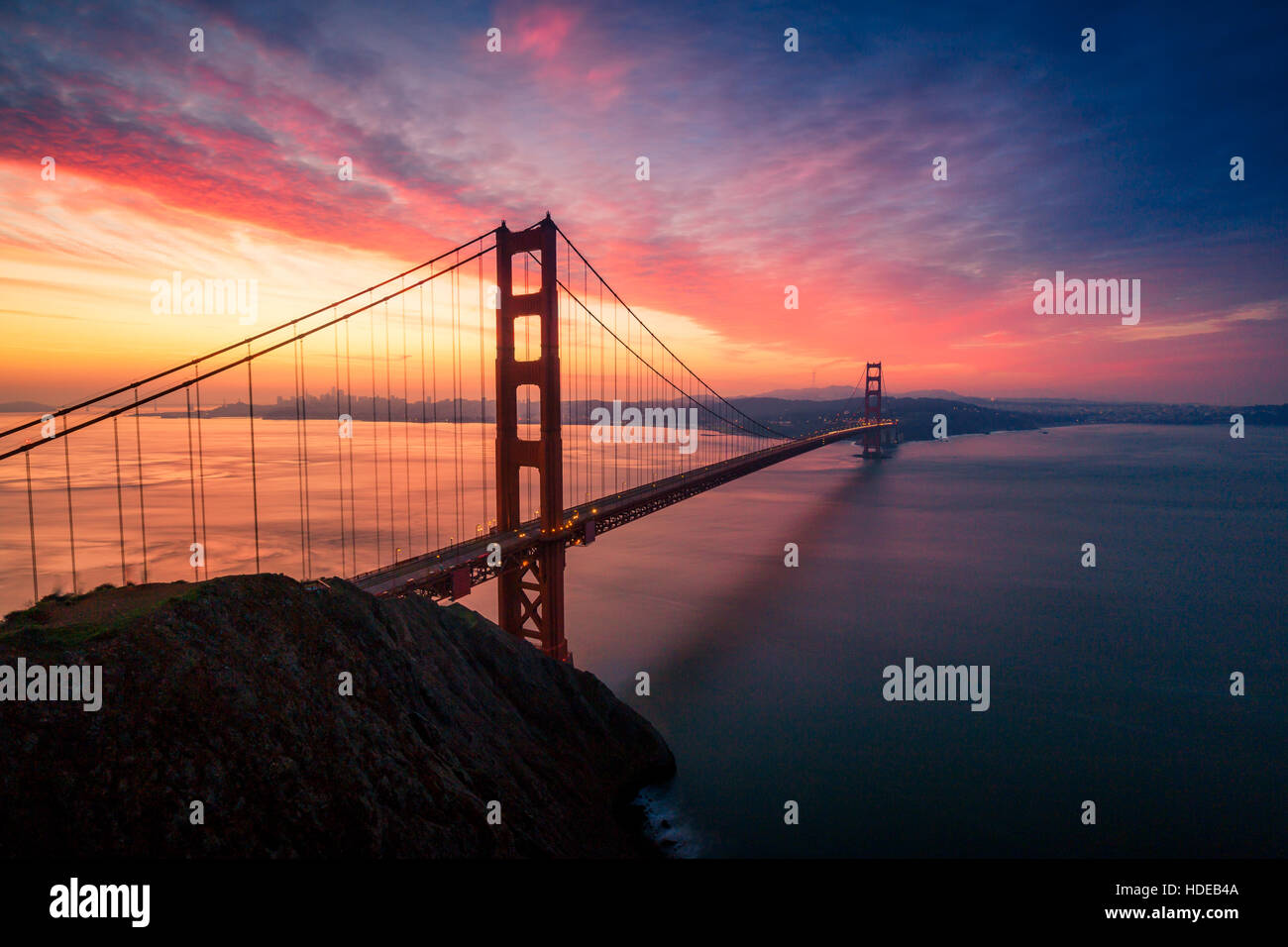 Colorful sunrise at the Golden Gate Bridge in San Francisco, California, USA - Stock Image