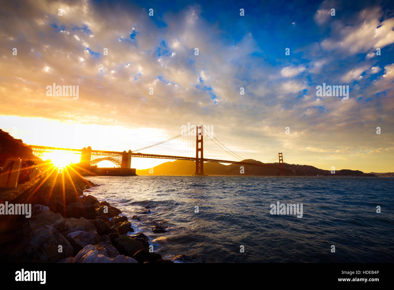 Sunset at the Golden Gate Bridge with sun starburst, San Francisco, California - Stock Image