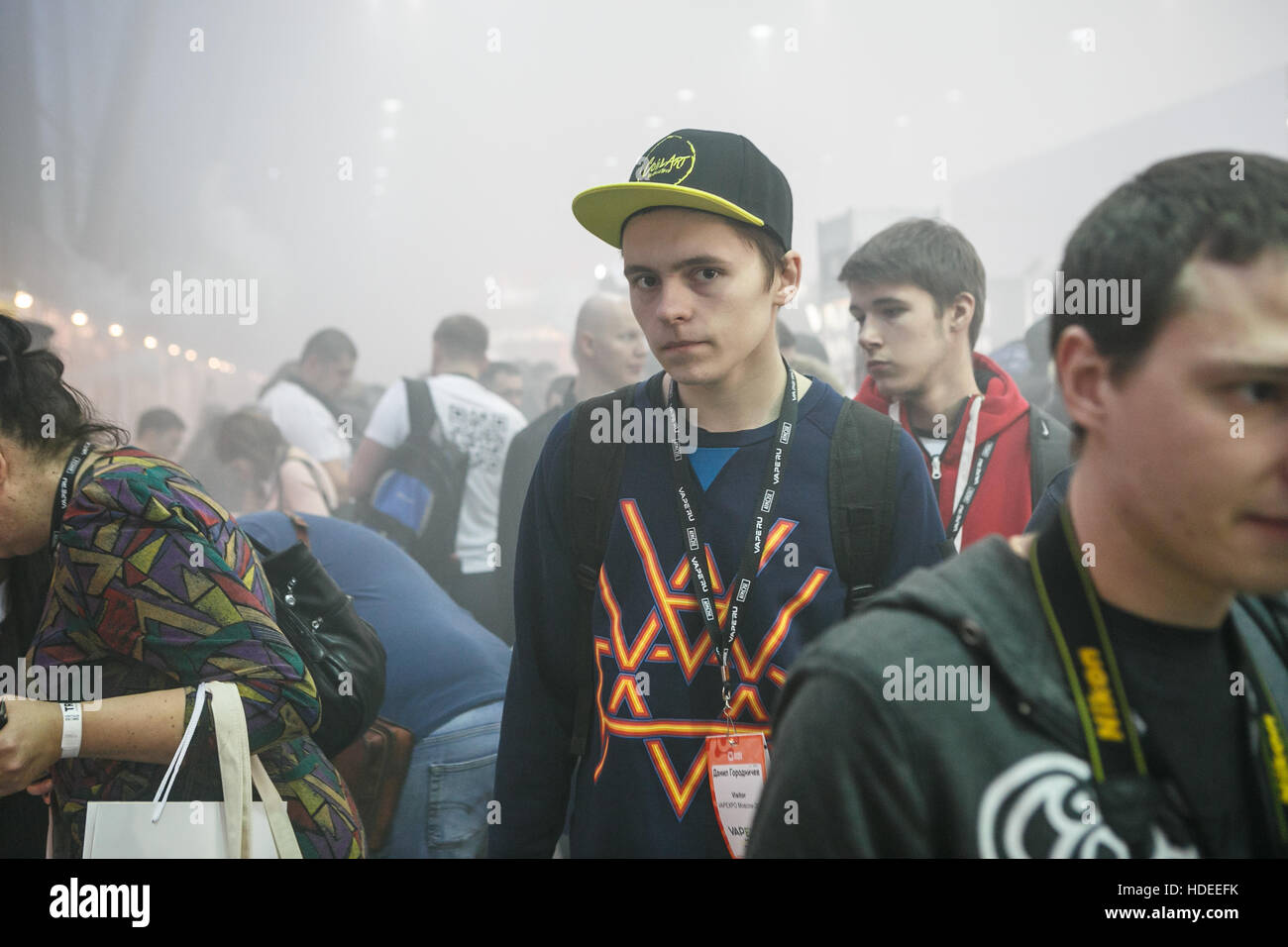 MOSCOW - 9 DECEMBER,2016: International Vape Expo.People at big vaping exposition.Visitor come to see new vaping - Stock Image