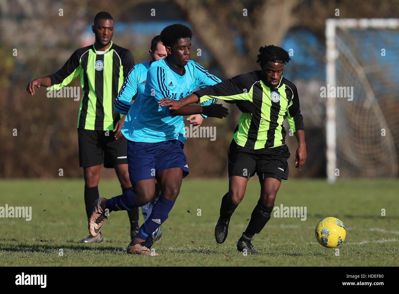 Eagle (green/black) vs Dynamics, Hackney & Leyton Sunday League Football at Hackney Marshes on 11th December - Stock Image