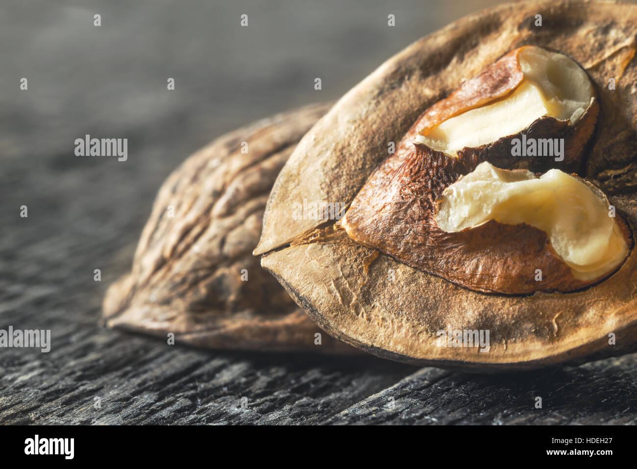 Walnut on the wooden table close-up - Stock Image