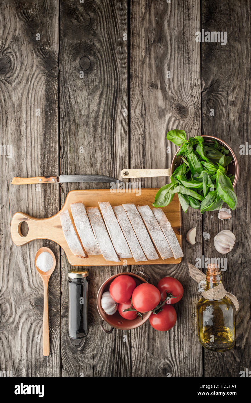 Ingredients for  bruschetta on the wooden table vertical - Stock Image