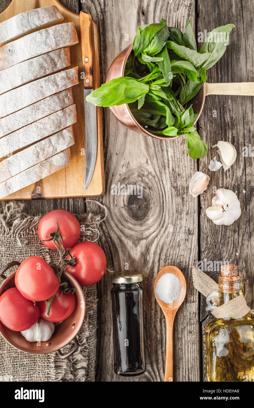 Ingredients for  bruschetta on the wooden table top view Stock Photo