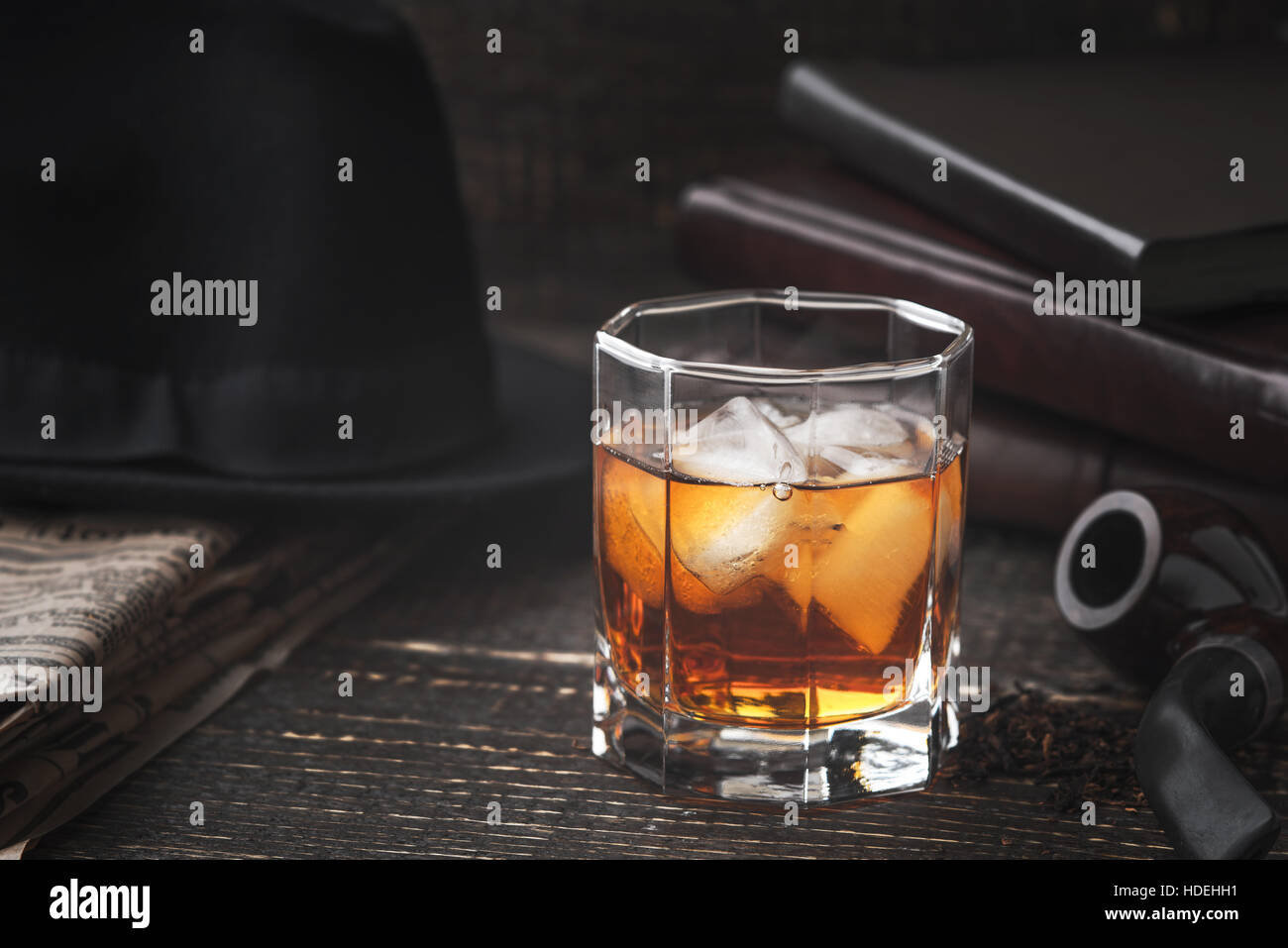 Whiskey with pipe , hat and newspaper horizontal - Stock Image