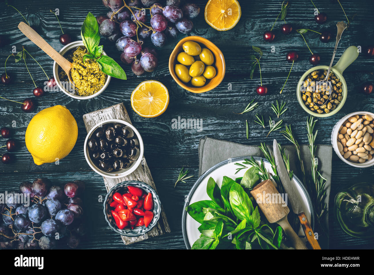 Concept of Mediterranean cuisine. Different fruit , herbs and appetizers on the wooden table top view Stock Photo