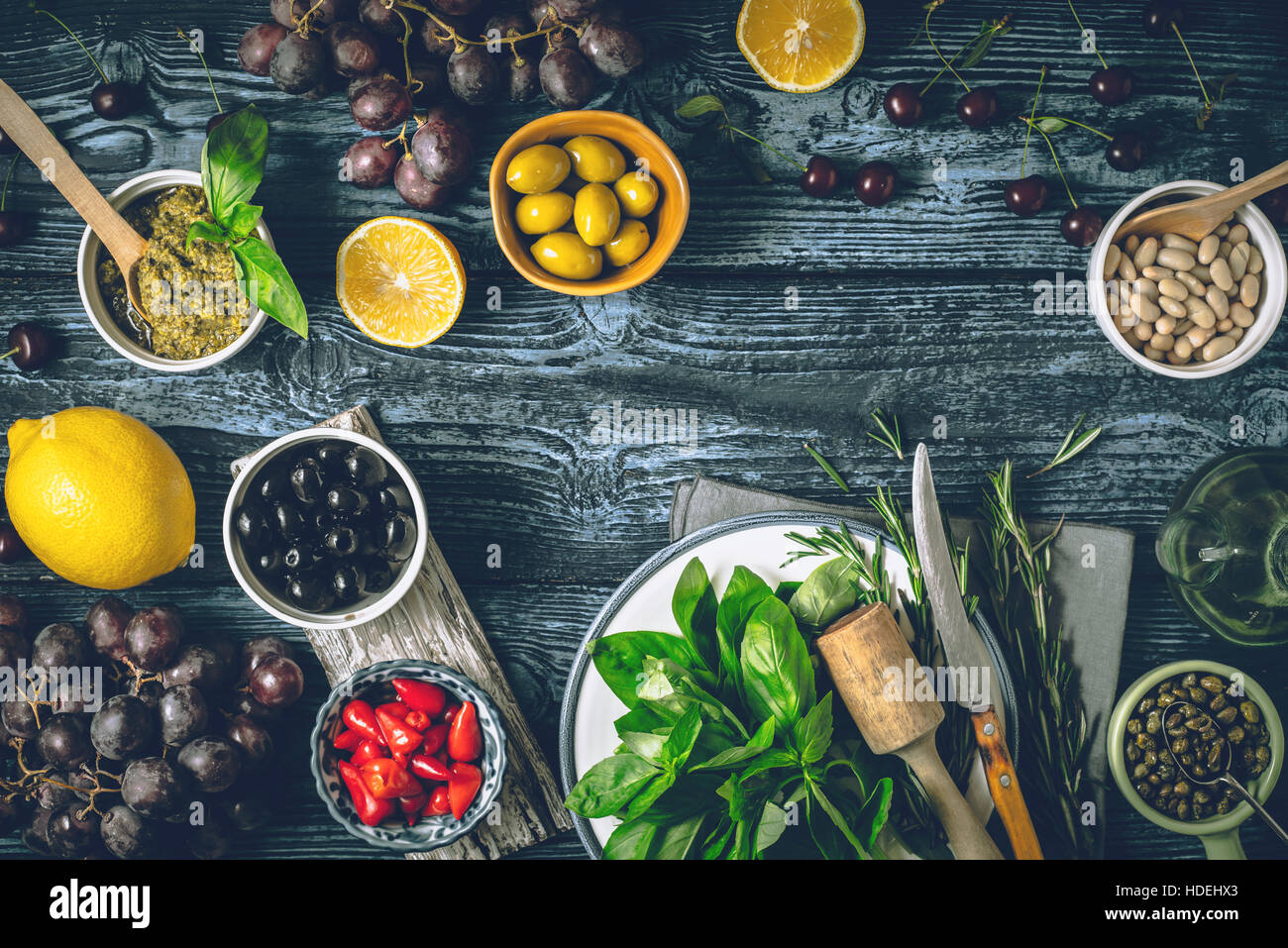 Concept of Mediterranean cuisine. Different fruit , herbs and appetizers on the wooden table horizontal - Stock Image