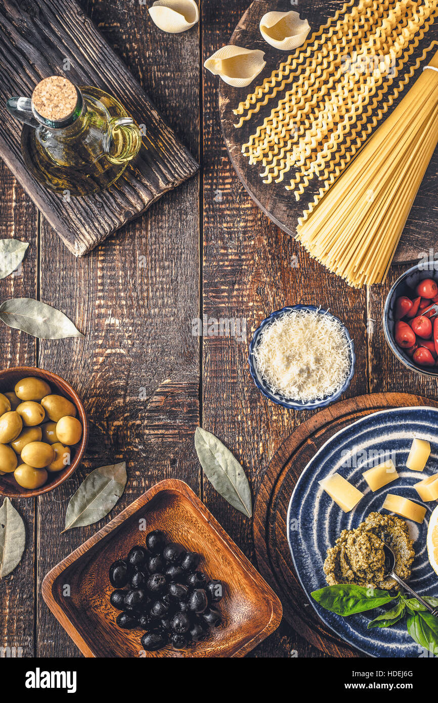 Ingredients of Italian cuisine on the wooden table vertical Stock Photo
