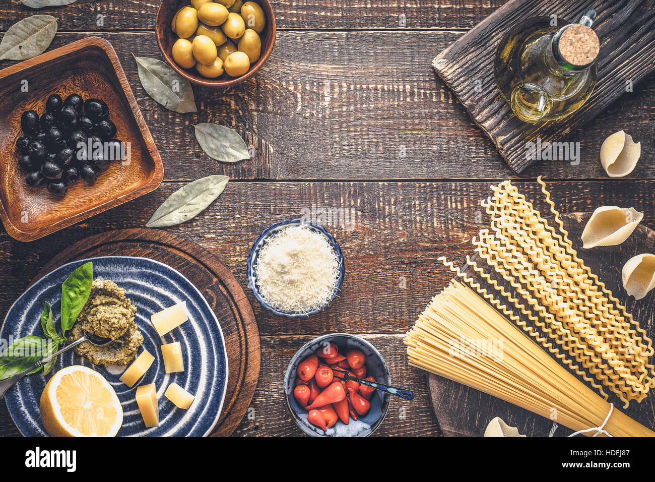 Ingredients of Italian cuisine on the wooden table top view Stock Photo
