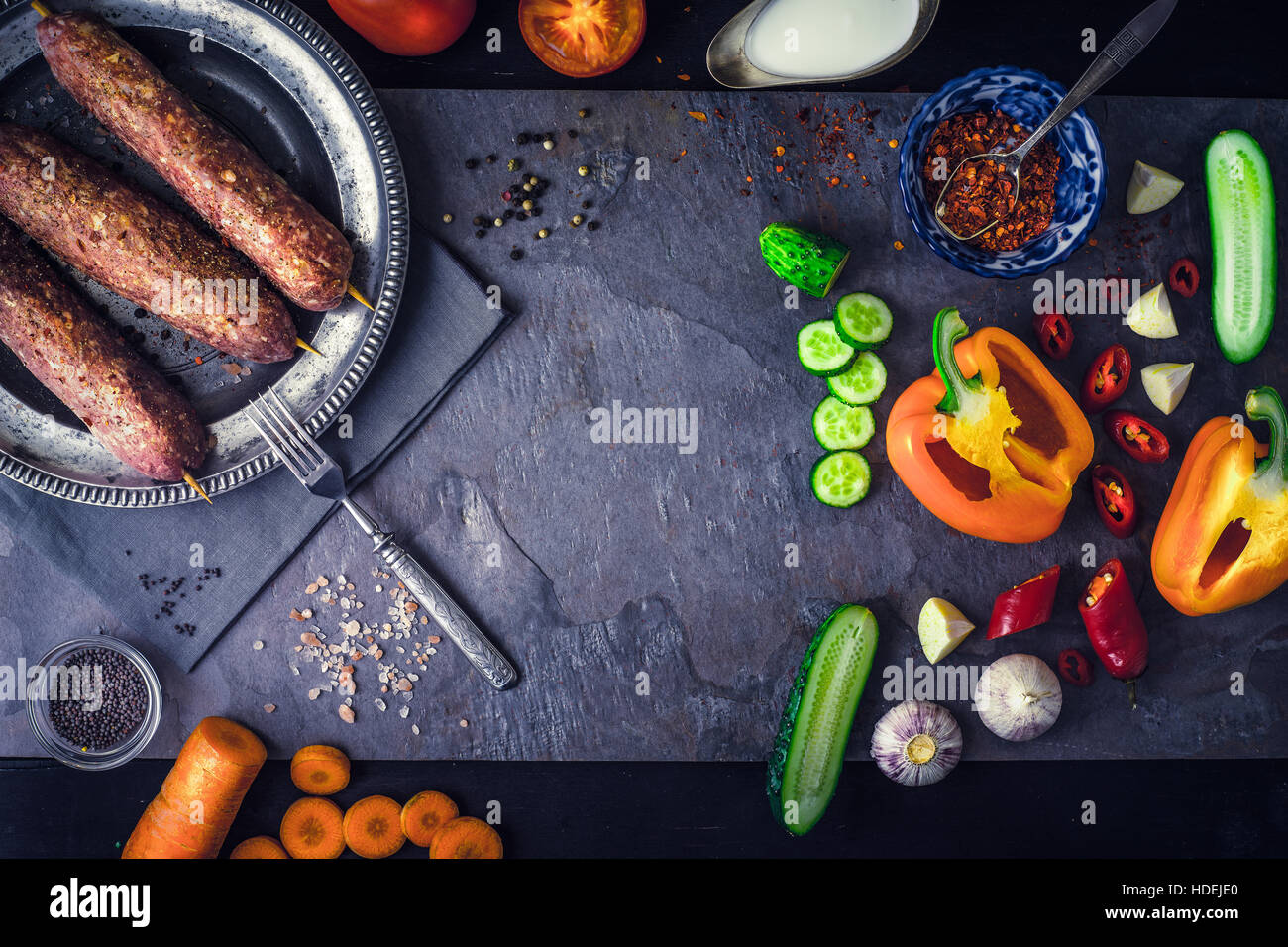 Kebabs with seasoning and vegetable. Concept Middle east , Asian and Caucasian cuisine - Stock Image