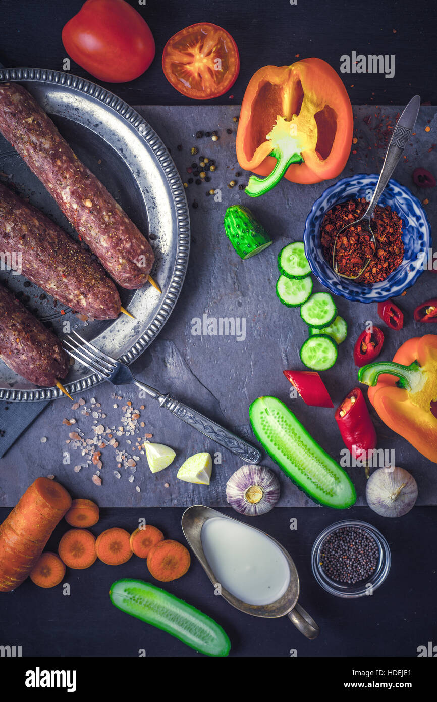 Kebabs with seasoning and vegetable. Concept Middle east , Asian and Caucasian cuisine vertical - Stock Image
