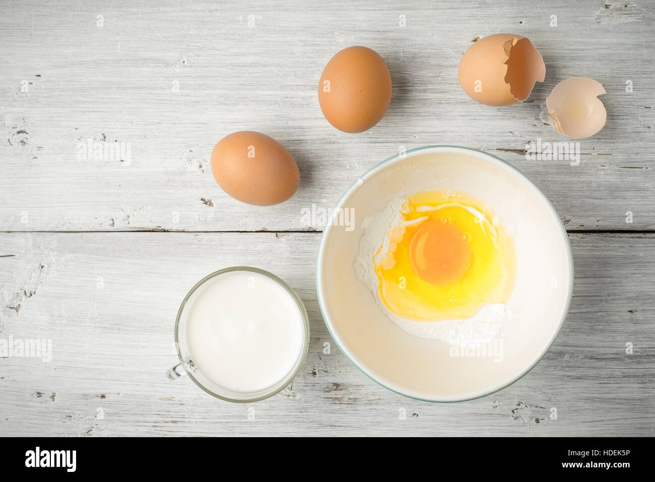 milk dairy yogurt egg cornstarch ingredient bowl - Stock Image