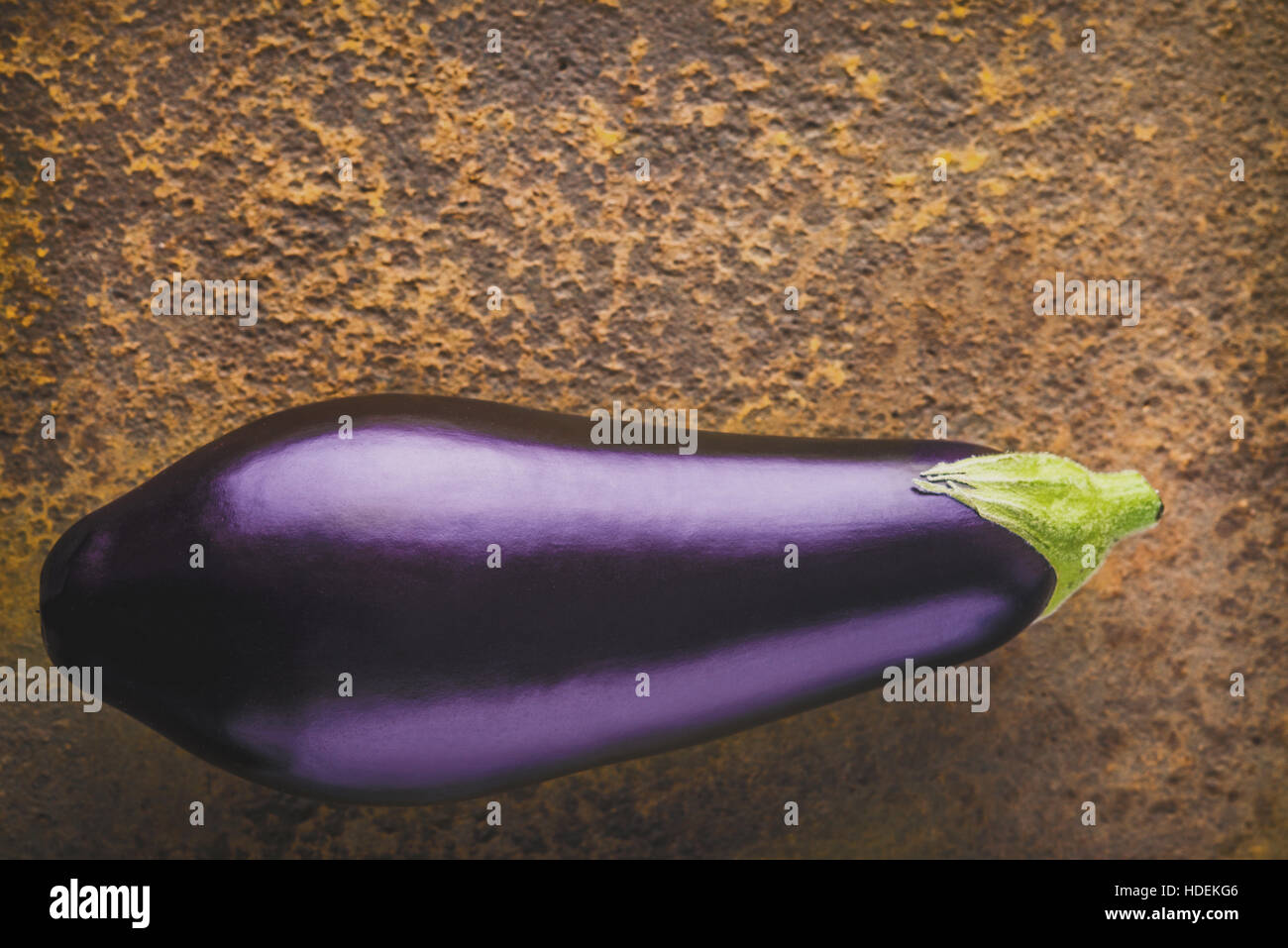 Eggplant on the brown stone background top view - Stock Image