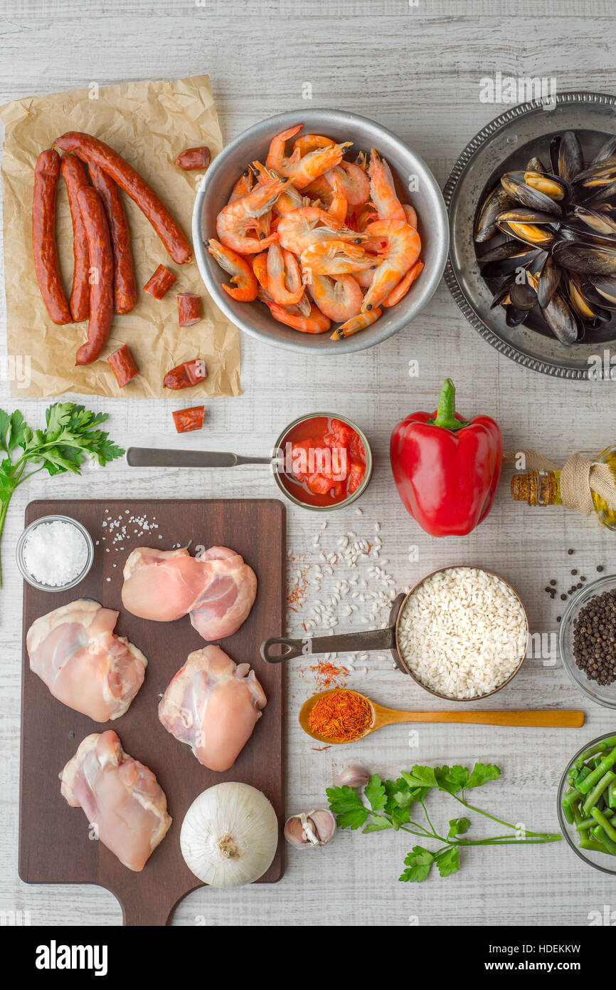 Ingredients for paella on the white  table vertical - Stock Image