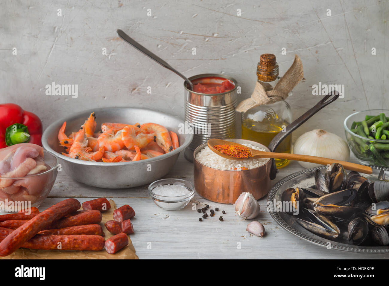 Ingredients for paella on the white scratched table horizontal - Stock Image